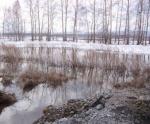 В Шарыпово уже началось подтопление домов частного сектора