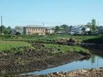В Ужуре ведутся работы по благоустройству реки