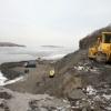 Дорожники Хакасии восстанавливают дамбу в подтопленной Кубайке